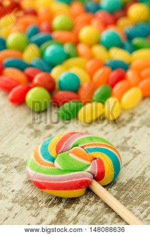 Colorful jelly beans and a round lollypop
