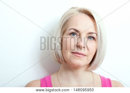 Magnificent portrait of beautiful middle aged woman with perfect skin closeup. Portrait of elegant middle aged woman