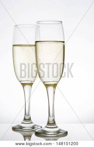 Glamorous champagne glass cups on white background