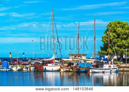 ISOLA SLOVENIA - AUGUST 30 2016: Boats in the Isola marina on bright summer day