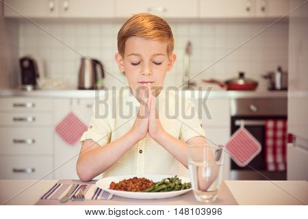 Cute Little Boy Saying Prayer Before Eating Meal