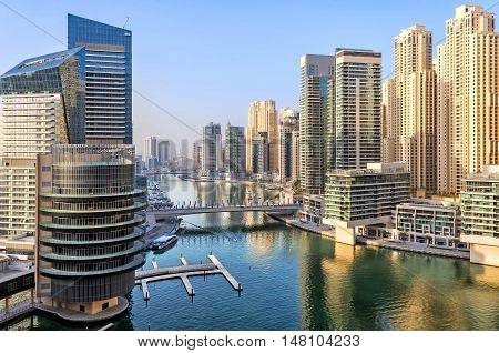 View of Dubai Marina skyscrapers in Dubai, UAE. Dubai Marina is a canal city carved along a two mile (3 km) stretch of Persian Gulf shoreline and is the heart of what has become known as