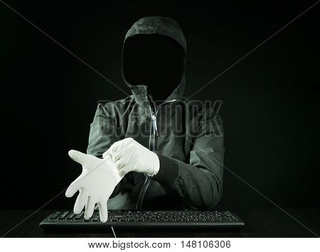 Hacker wearing gloves for to leave fingerprints