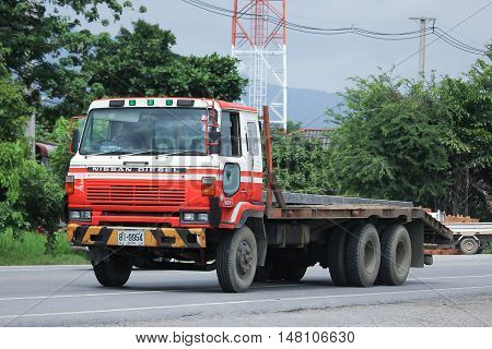 CHIANGMAI THAILAND -AUGUST 18 2016: Private Old Nissan Diesel Truck. On road no.1001 8 km from Chiangmai city.