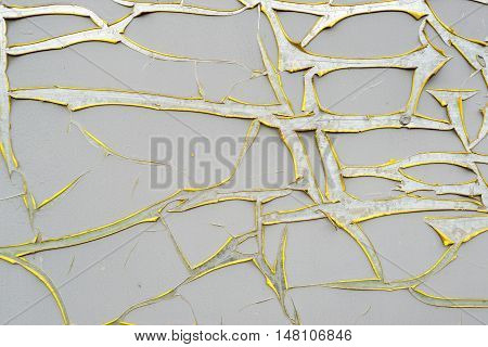 Damaged craquelure sticker wrap grey and yellow. Old wall background texture
