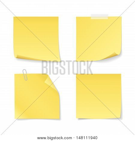 Set of sticky notes with clip and adhesive tape. Vector yellow paper with curled corner for your message. Isolated from a background.