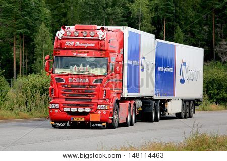 PAIMIO FINLAND - AUGUST 5 2016: Red customized super Scania refrigerated truck of KB Transport moving along road in South of Finland at summer.