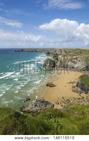 Bedruthan steps beach in Cornwall UK on a sunny summer day.
