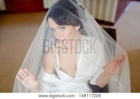 Beauty Bride In Dressing Gown With Bridal Makeup Indoors. Beautiful Model Girl In Colorful Wedding R