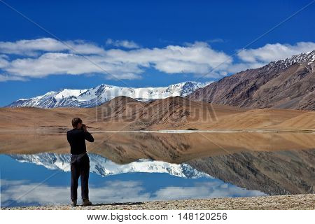 LADAKH, INDIA - JUNE 20, 2012: Tourist walking at Tso Kar lake in Ladakh, North India. Tso Kar is a lake located in Rupsa valley nearly 240 km southeast of Leh.