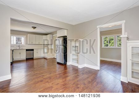 White Kitchen Room Interior With Marble Counter Top And Hardwood Floor.