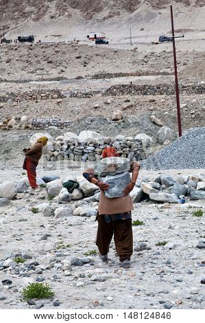 Unidentified Indian women working hard in road-building in the Indian Himalayas Jammu and Kashmir State North India