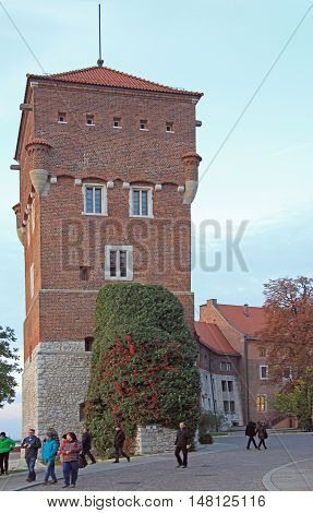 Krakow, Poland - October 29, 2015: people are walking nearly Thieves Tower of Wawel castle in Krakow, Poland