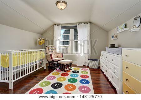 Kids Bedroom With Nice Crib And Colorful Rug