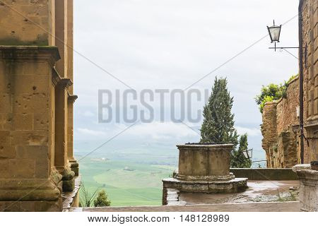 PIENZA,ITALY-APRIL 23,2016:panoramic views over the Tuscan hills from Pienza center during a foggy day.