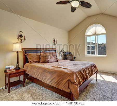 Upstairs Bedroom With Vaulted Ceiling And Arch Window