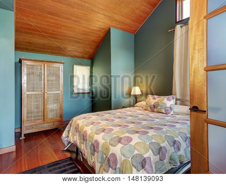Cosy Upstairs Bedroom With Minimal Design And Wardrobe.