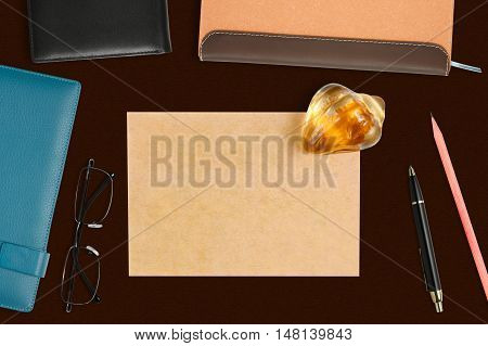 recycle paper note with shell paperweight & stationery on the desk