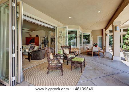 Relaxing Outdoor Seating Arrangement Of Luxury House.