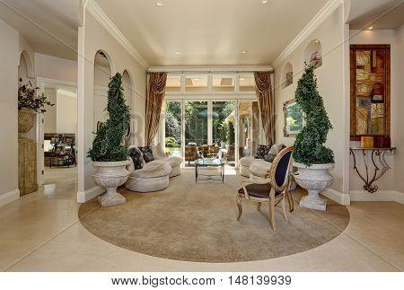 Amazing Luxury Entrance Hallway Interior With Decorative Trees In Pots.