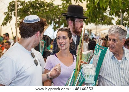 JERUSALEM, ISRAEL - OCTOBER 8, 2014: Religious Jews are buying products for the holiday. Sukkot in Israel. Traditional holiday market in Jerusalem