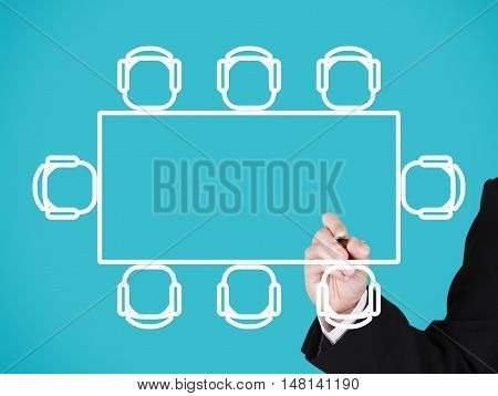 businessman writing on blank rectangle meeting table blue background