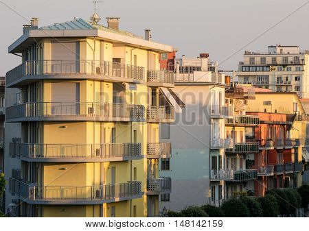 Buildings and palaces massed in a seaside resort in the Mediterranean.