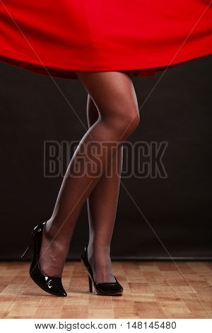 Woman Legs In Black High Heels On Party Floor