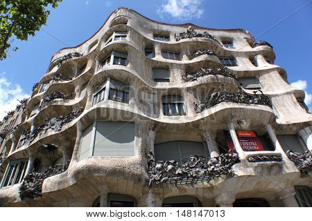 SPAIN, BARCELONA - JULY 20, 2011: Casa Mila, better known as La Pedrera, designed by Antoni Gaudi. Part of the UNESCO World Heritage Site in Barcelona, Spain.