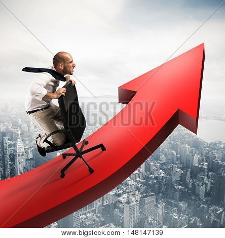 Determined businessman over a big red arrow