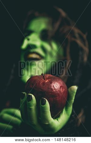 Rotten Apple On A Witch Hand