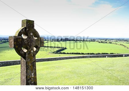 Gaelic cemetery with beautiful green fields in the background