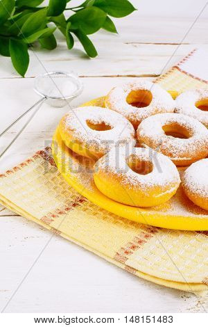 Sweet donuts with caster sugar. Hanukkah homemade donuts. Sweet dessert. Sweet pastry doughnuts.