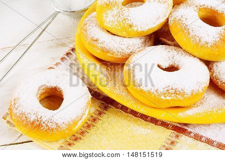 Donuts with caster sugar on checkered napkin. Hanukkah sweet donuts. Sweet dessert pastry doughnuts.
