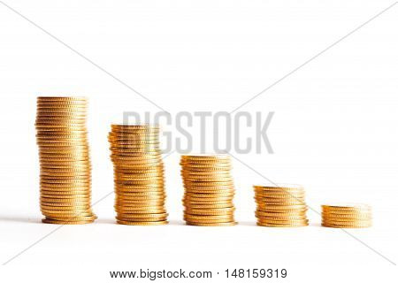 Coin stacks on a white background. Studio shot