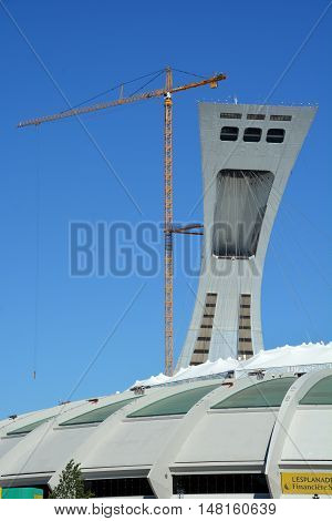 MONTREAL CANADA 09 12 2016. Men repair the Montreal Olympic Stadium tower. It's the tallest inclined tower in the world.Tour Olympique stands 175 meters tall and at a 45-degree angle