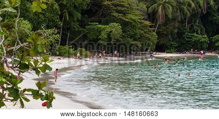 Manuel Antonio Costa Rica - May 06: People enjoying the warm water in this protected beach. May 06 2016 Manuel Antonio Costa Rica.