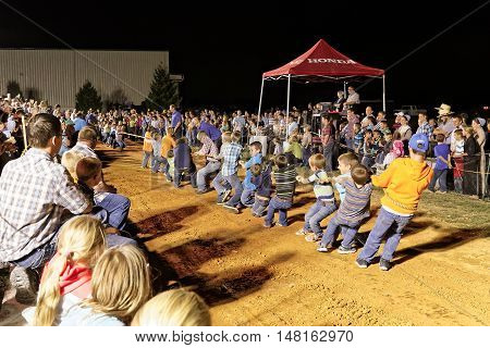 MYERSTOWN PENNSYLVANIA - SEPTEMBER 16 2016: Young boys pull rope in the nine years and under tug-of-war contest at Myerstown East End Days. This is an annual community event.