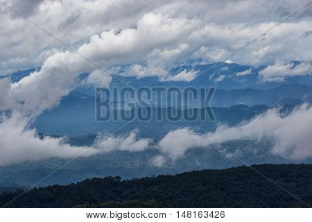 Layer of mountains and mist at sunrise time Landscape at monjam hill High mountain in Chiang Mai Province Thailand
