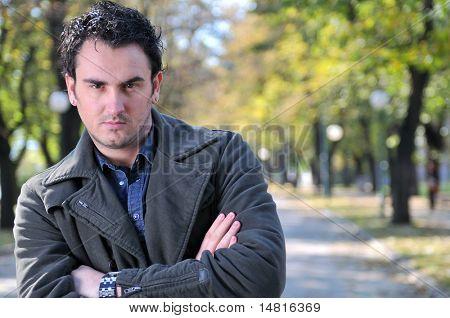 happy young casual man outdoor portrait posing