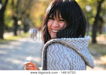 brunette Cute young woman smiling outdoors in nature