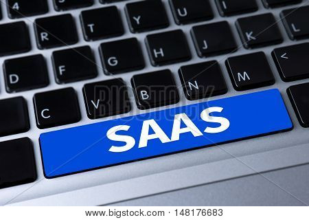 SAAS a message on keyboard businessman working businessman working