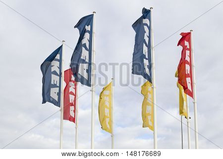 VILNIUS, Lithuania - September 18, 2016: IKEA flags against sky at the IKEA Vilnius Store. IKEA is the world's largest furniture retailer. It was founded in Sweden in 1943.