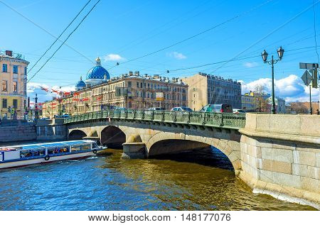 ST PETERSBURG RUSSIA - APRIL 25 2015: The chain suspension Izmailovsky Bridge over Fontanka River links Voznesensky Prospekt with Izmailovsky Prospekt on April 25 in St Petersburg.