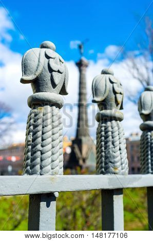 The Russo-Turkish War Memorial Column between the fence finials at the Trinity Cathedral in St Petersburg Russia.