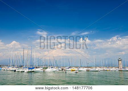 Desenzano, Lombardy, northern Italy, 15th August 2016: Small yachts and boats in harbor of Desenzano del Garda, lake Garda, Italy