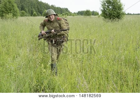 Soldier with a rifle in the field. Reconstruction 1941-1945