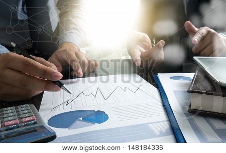 Business Documents On Office Table With Smart Phone And Laptop Computer
