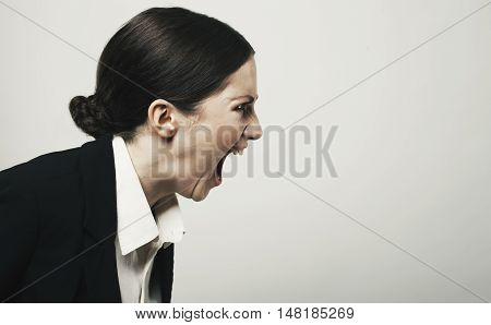 Beautiful Young  Angry Woman Screaming Studio Shot