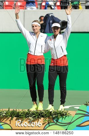 RIO DE JANEIRO, BRAZIL - AUGUST 14, 2016: Silver medalists team Switzerland Timea Bacsinszky (L) and Martina Hingis during medal ceremony after tennis women's doubles final of the Rio 2016 Olympics